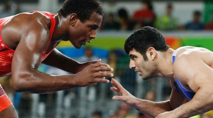 'Very happy to be here in Iran': US and Iran face off in wrestling final
