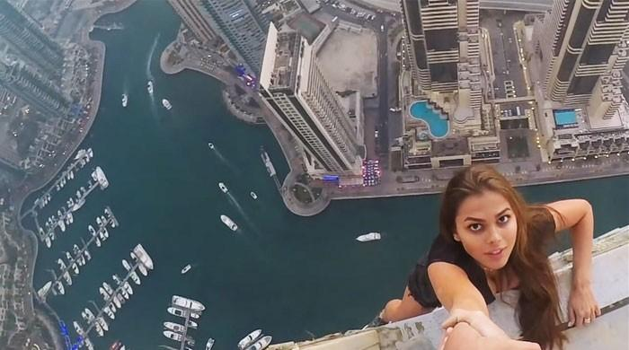 Dubai police summon Russian model who dangled from skyscraper: newspaper