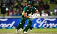 De Villiers steers South Africa home with a ball to spare