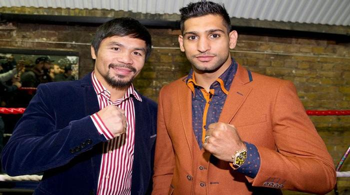 Amir Khan to fight Manny Pacquiao in April