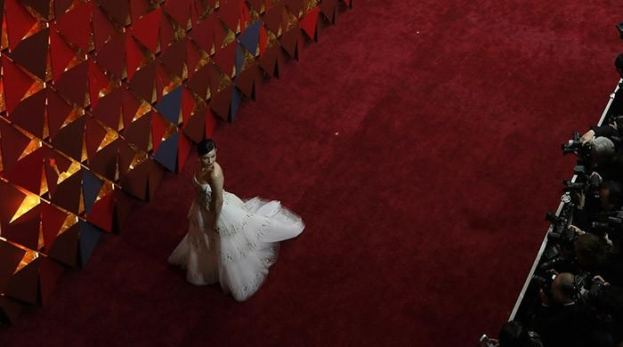 Stars shimmer on Oscar red carpet as diamonds and gold have their day