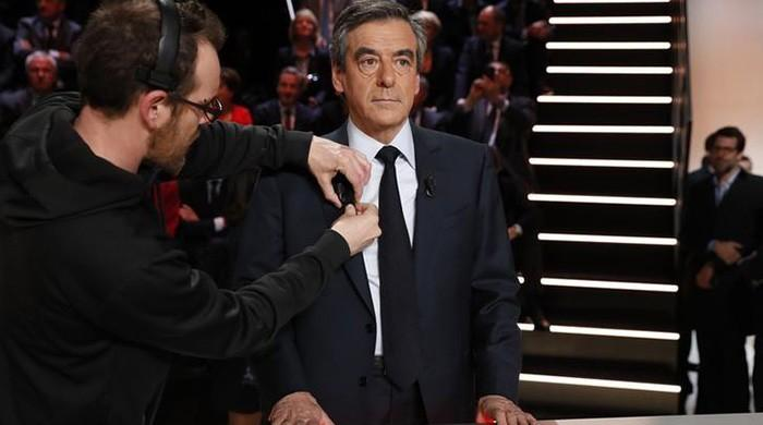 Fillon criticises Merkel refugee policies in French TV debate