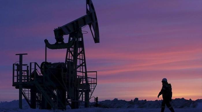 Oil edges up as Saudis cut supplies to US, but global glut remains