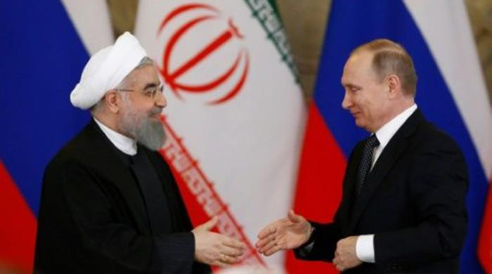 Russia, Iran ink economic deals as Rouhani visits Moscow