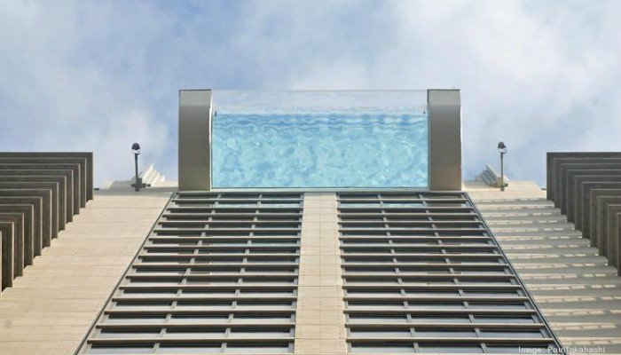 This sky glass pool in downtown houston will send shivers down your spine amazing for Houston swimming pool high rise