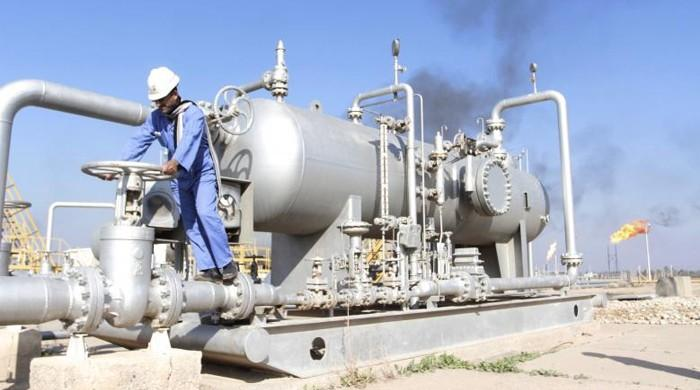 Oil little changed amid rising US output, OPEC production cuts