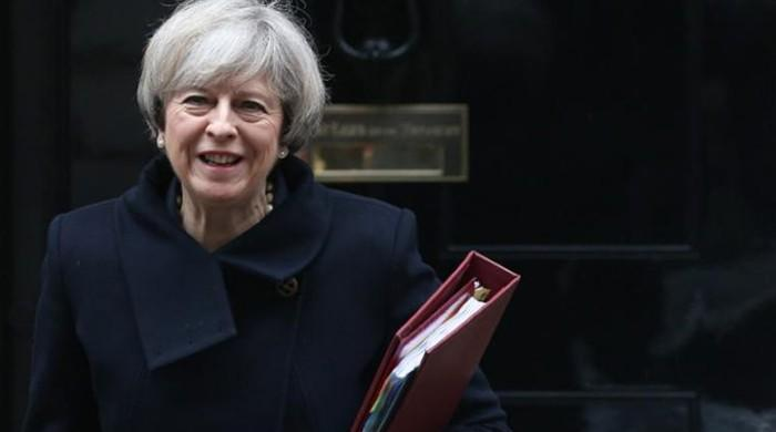 May criticised over snap general elections