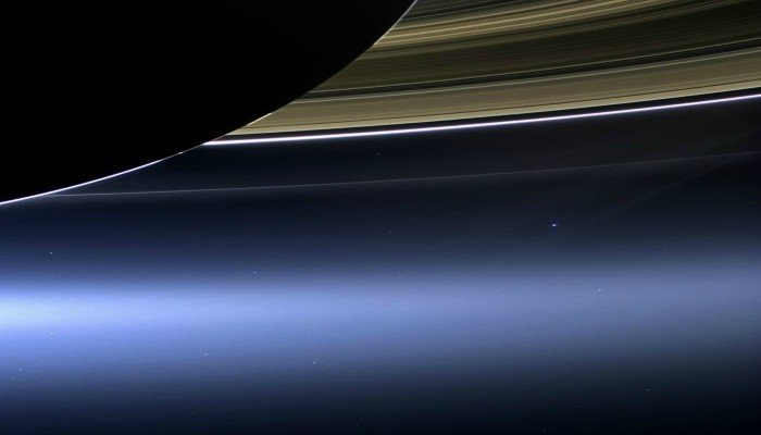 WATCH: NASA reveals stunning image of Earth through Saturn ...