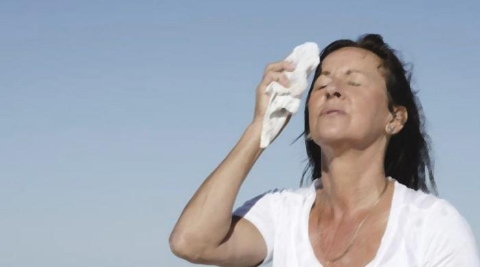 Hot flashes at younger ages may signal higher heart risk later