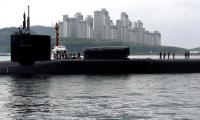 North Korea puts on live-fire drill as US sub docks in South