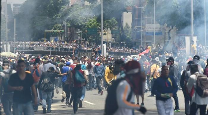Venezuela opposition defiant as protesters shot dead