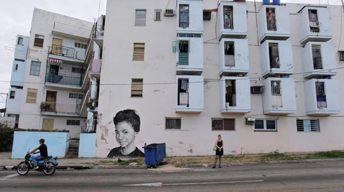 Havana walls brought to life with murals of wide-eyed children