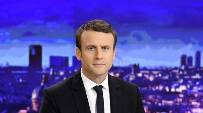 France's Macron says 'nothing's won yet'
