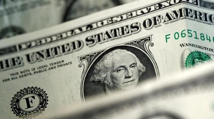 Dollar index edges up, but poised for losing month
