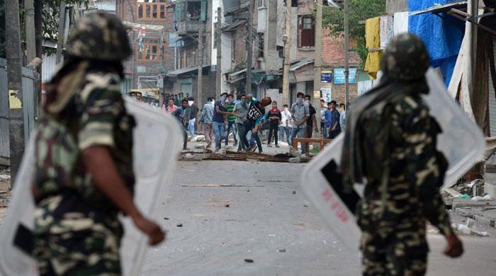 Image result for Protesters Force Troops To Call Off Cordon Operation in IOK