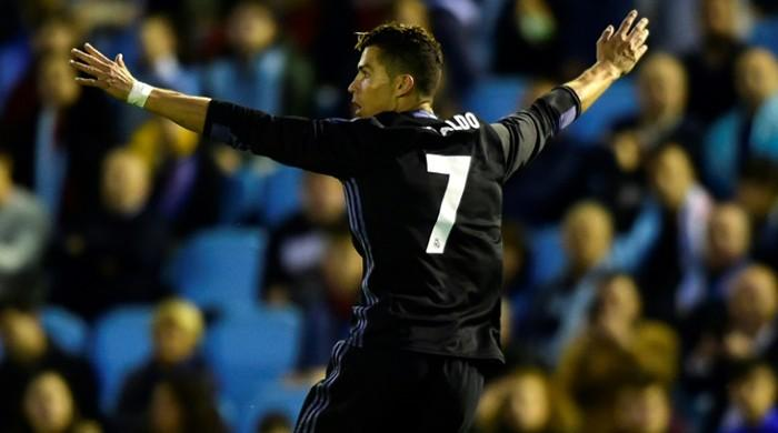 Ronaldo double puts Real Madrid within point of title