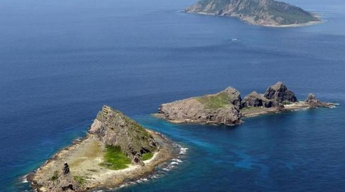 Japan protests to China over drone flight near disputed islets