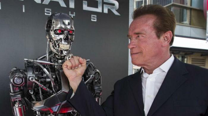 Schwarzenegger says you can have four Hummers and still save planet
