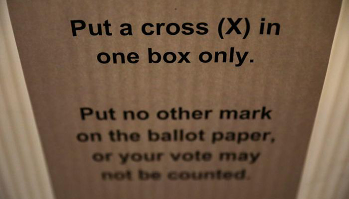 Instructions are seen inside a polling station on general election day in London, Britain, June 8, 2017 - Reuters