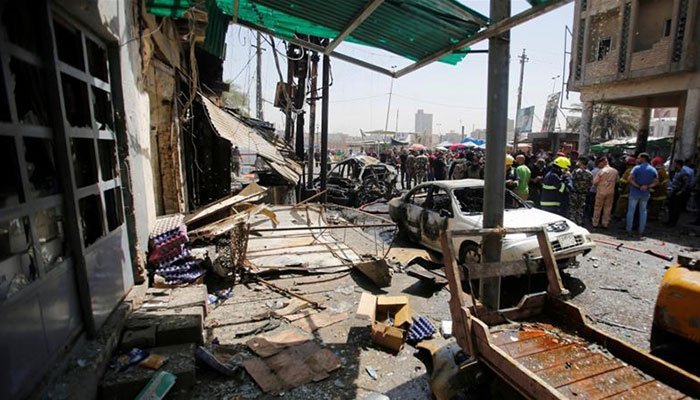 Twin blasts in Iraq kill 21, wound dozens