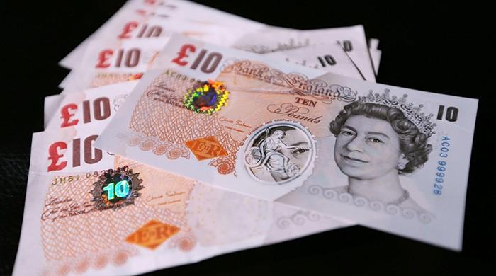 Sterling sinks after May seen falling short of majority