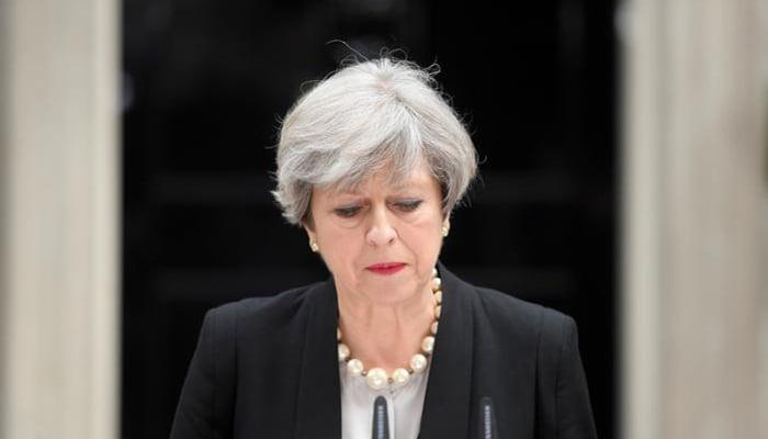 UK, EU in suspense as May tries to strike power deal