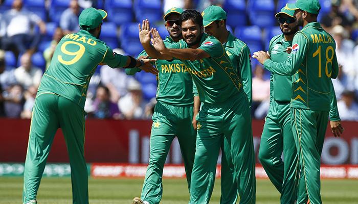 Rumman Raees celebrates with teammates after England´s Alex Hales - Reuters