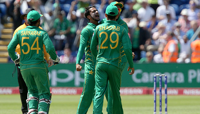 Hasan Ali (C) celebrates taking the wicket of England´s Jonny Bairstow (unseen) for 43 runs during the ICC Champions Trophy semi-final - AFP