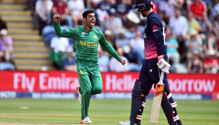 Shadab Khan celebrates after taking the wicket of England´s Joe Root (unseen) for 46 runs during the ICC Champions Trophy semi-final cricket match between England and Pakistan - AFP