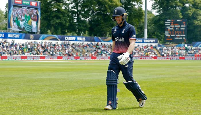 Eoin Morgan walks off dejected after losing his wicket - (Reuters)