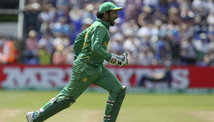 Sarfraz Ahmed celebrates the wicket of England´s Moeen Ali during the ICC Champions Trophy semi-final cricket match - AFP