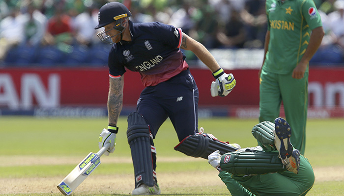 Ben Stokes (L) makes his ground during the ICC Champions Trophy semi-final cricket match - AFP