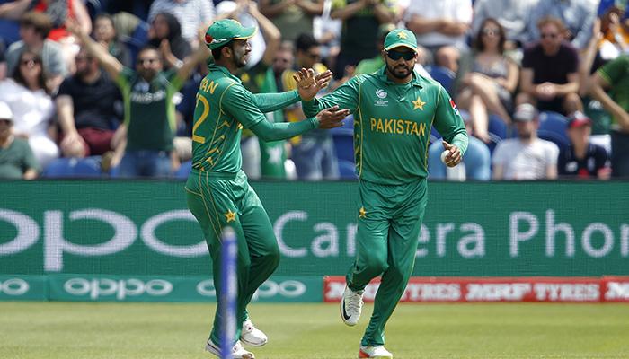 Azhar Ali celebrates taking a catch to dismiss England´s Liam Plunkett - Reuters