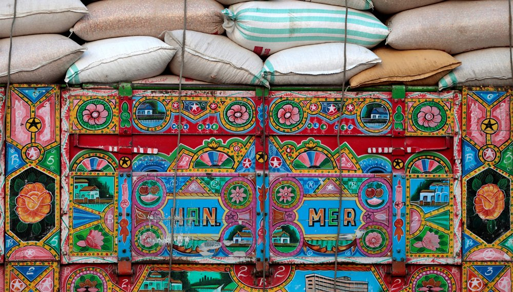 Artwork is seen on a decorated truck carrying sacks of wheat in Charsadda, Pakistan, May 1, 2017. REUTERS/Caren Firouz