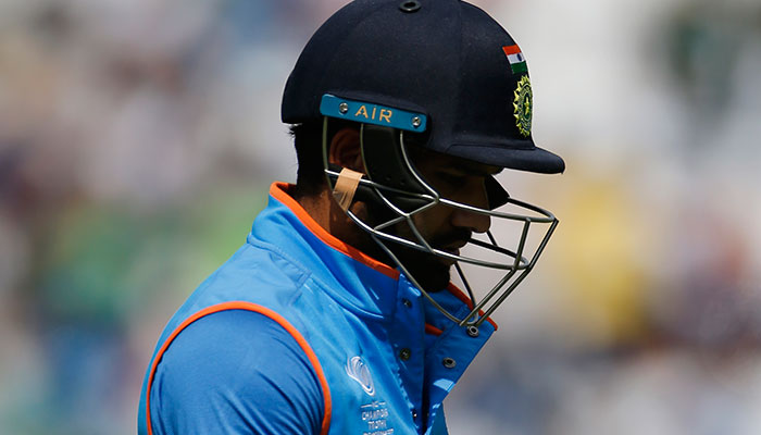 India´s Rohit Sharma walks off dejected after losing his wicket.—Reuters photo