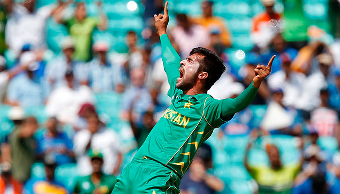 Pakistan´s Mohammad Amir celebrates taking the wicket of India´s Rohit Sharma