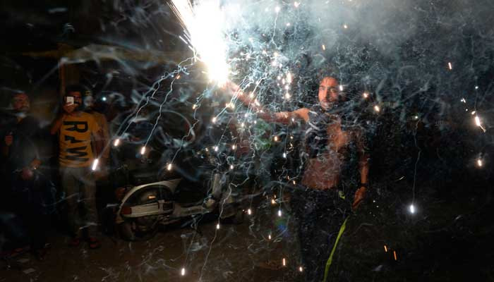 Kashmiris play with fireworks as they celebrate after Pakistan won the Champions Trophy AFP