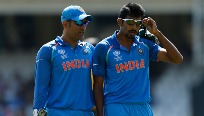 MS Dhoni speaks with Jasprit Bumrah at the end of an over during which he took a wicket with a no ball