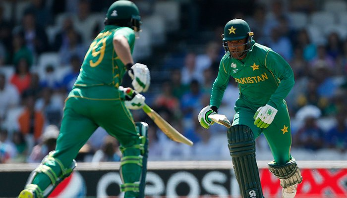 Azhar Ali (L) and Fakhar Zaman run - Reuters