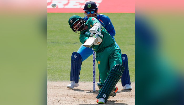 Azhar Ali hits the ball for six runs during the ICC Champions Trophy final  - AFP