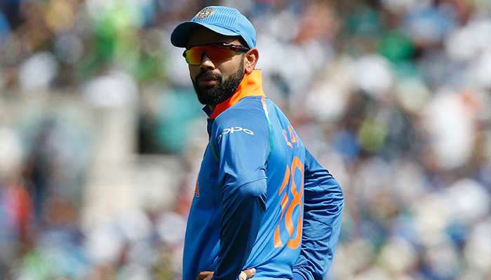 India´s captain Virat Kohli fields during the ICC Champions Trophy final cricket match  - AFP
