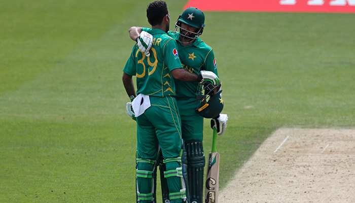 Pakistan´s Azhar Ali (R) celebrates with Pakistan´s Fakhar Zaman (L) after reaching his 50 during the ICC Champions Trophy final cricket match between India and Pakistan - AFP