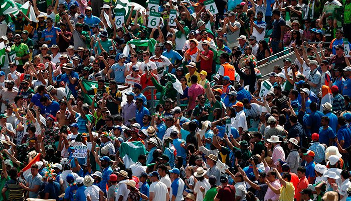 Crowd react as another six is hit during the ICC Champions Trophy final cricket match between India and Pakistan - AFP
