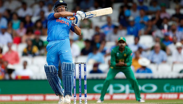 MS Dhoni in action before Pakistan's Imad Wasim catches him out.—Reuters photo