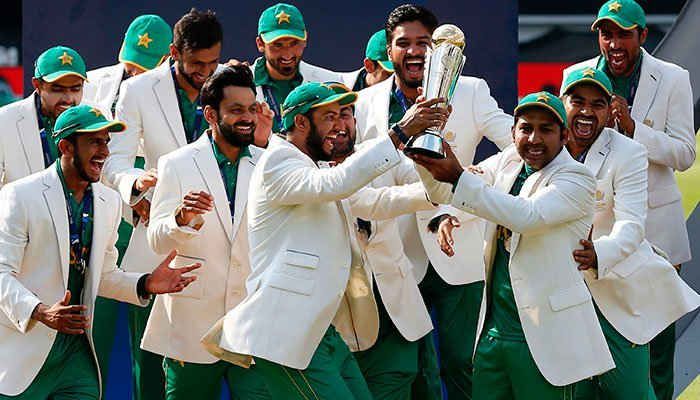 Sarfraz Ahmed (R) lifts the trophy as Pakistan players celebrate their win at the presentation after the ICC Champions Trophy final cricket match between India and Pakistan at The Oval in London on June 18, 2017.—Reuters photo