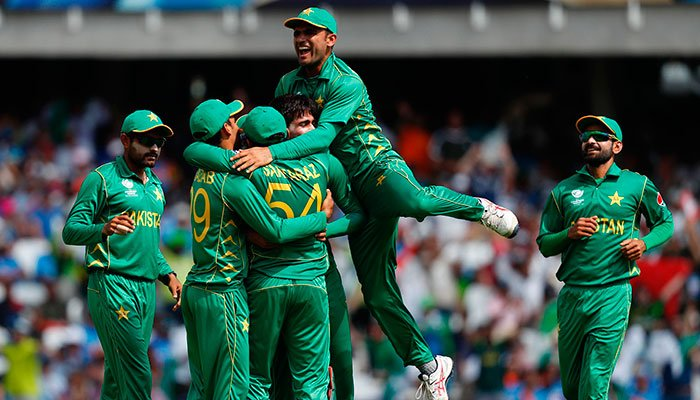Amir celebrates with teammates after taking the wicket of India´s Shikhar Dhawan for 21 during the ICC Champions Trophy final cricket match between India and Pakistan at The Oval in London on June 18, 2017.—AFP photo