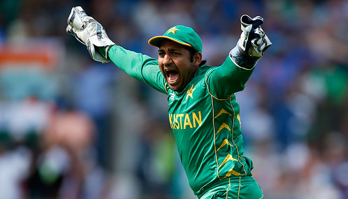 Sarfraz Ahmed celebrates the wicket of India´s MS Dhoni.—Reuters photo