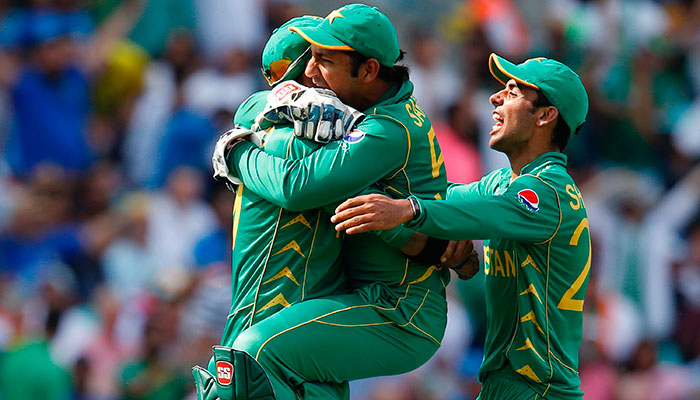 Pakistan´s Shadab Khan (R) and Pakistan´s Sarfraz Ahmed (C) celebrate with Pakistan´s Imad Wasim after he catches India´s MS Dhoni during the ICC Champions Trophy final cricket match between India and Pakistan at The Oval in London on June 18, 2017.—AFP photo