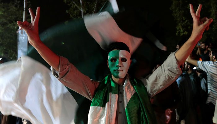 Pakistani cricket fans cheer after Pakistan defeated India in the Champions Trophy finals, in Islamabad