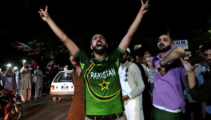Fans in Pakistan celebrate the stunning win